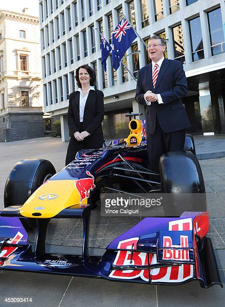 Premier of Victoria the Hon Dr Denis Napthine and Louise Asher Minister for Tourism pose next to an Infiniti Red Bull Racing Formula One car during...