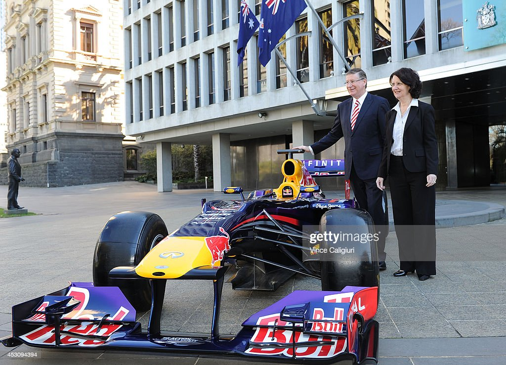 Premier of Victoria, the Hon Dr Denis Napthine and Louise Asher, Minister for Tourism pose next to an Infiniti Red Bull Racing Formula One car during an AGPC media announcement at the State Government Office on August 3, 2014 in Melbourne, Australia.