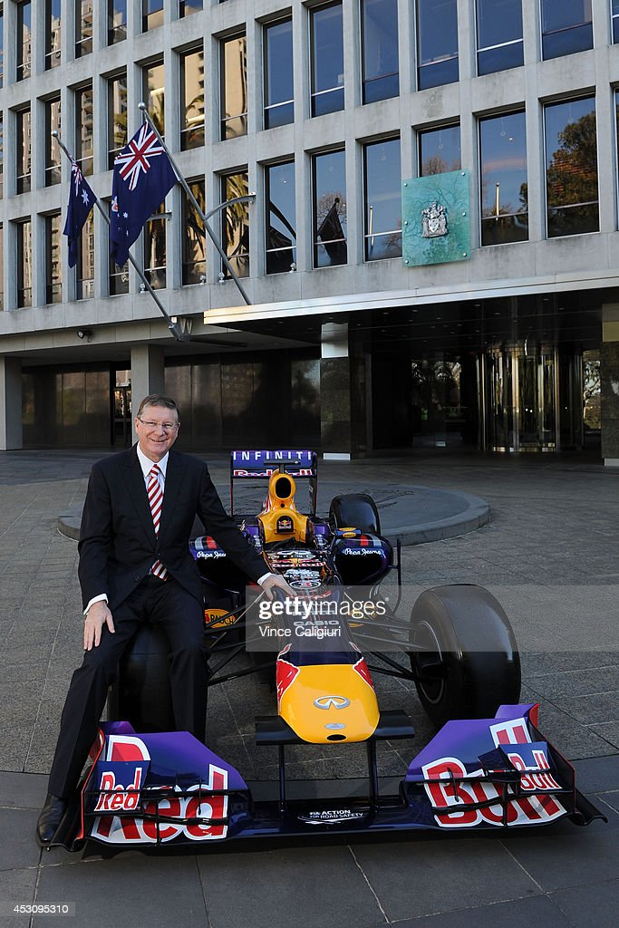 Premier of Victoria, the Hon Dr Denis Napthine poses next to an Infiniti Red Bull Racing Formula One car during an AGPC media announcement at the State Government Office on August 3, 2014 in Melbourne, Australia.