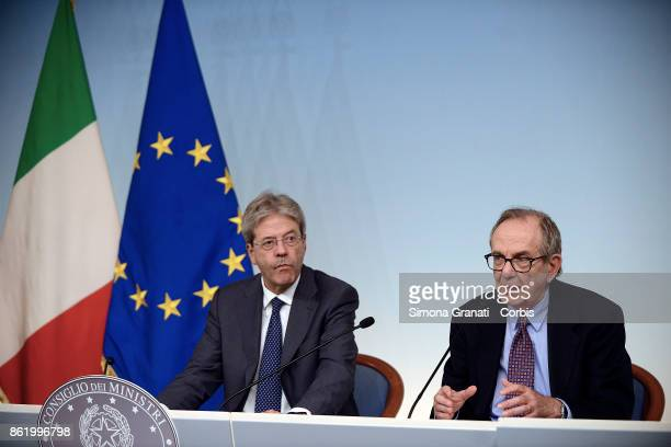 Premier Paolo Gentiloni and Economy Minister Pier Carlo Padoan speaking at a press conference after cabinet on the 2018 budget bill just approved by...