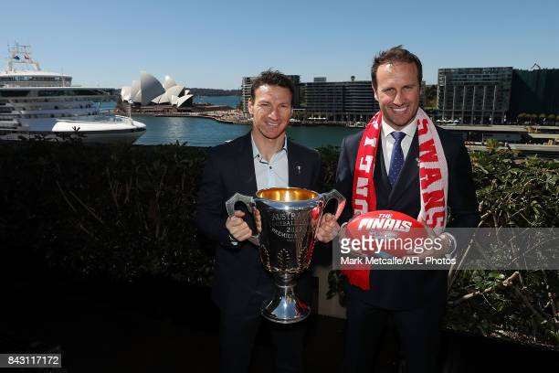 Premiership Cup Ambassador Brent Harvey and former Sydney Swans Premiership player Jude Bolton pose with the AFL trophy during the AFL Grand Final...