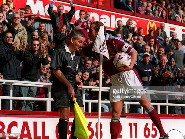 Premiership Football West Ham United v Coventry City Paolo Di Canio plants a kiss on the head of assistant referee Roy Burton much to the delight of...