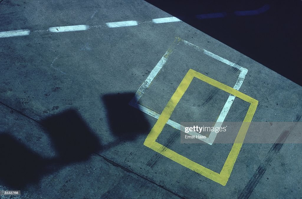 A shadow and markings on a pavement. Colour photography book