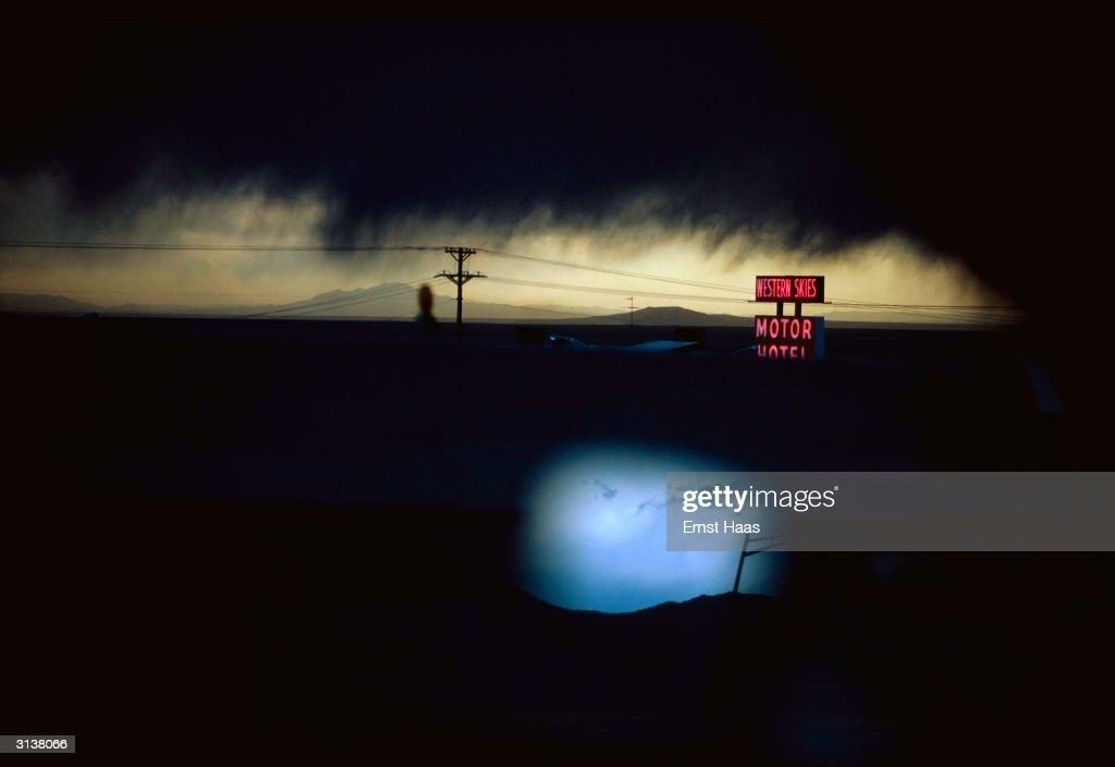 A cloudy night sky over the Western Skies Motor Motel in Colorado. Colour Photography book.