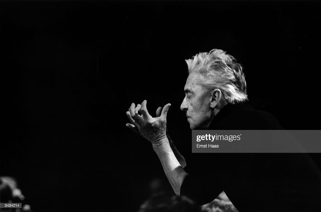 Herbert von Karajan (1908 - 1989) is caught up in the passion of the music when he conducts at Salzburg. In black and white book