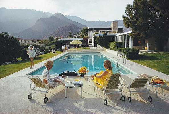 Premium Rates Apply A desert house in Palm Springs designed by Richard Neutra for Edgar J Kaufmann Lita Baron approaches Helen Dzo Dzo and Nelda...