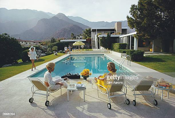 Premium Rates Apply A desert house in Palm Springs designed by Richard Neutra for Edgar J Kaufmann Lita Baron approaches Helen Dzo Dzo and Nelda...