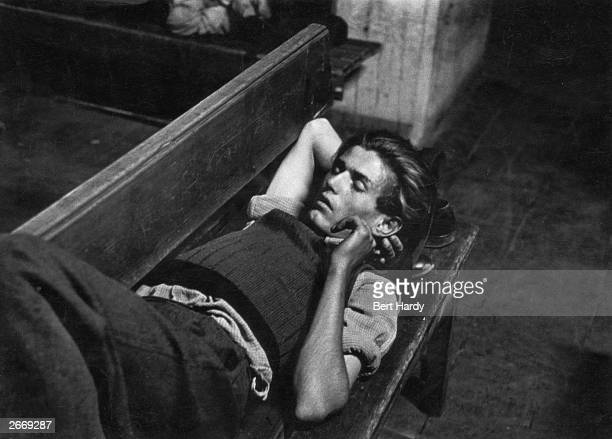 Premium Rates Apply A refugee from the Russian communist zone in east Germany sleeps on a bench at Hamburg Station a victim of the postwar...