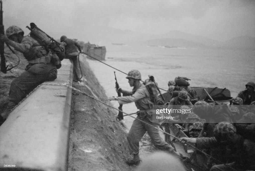 Premium Rates Apply American troops come ashore at Inchon during the Korean War and scale the sea wall Original Publication Picture Post 5086 Inchon...