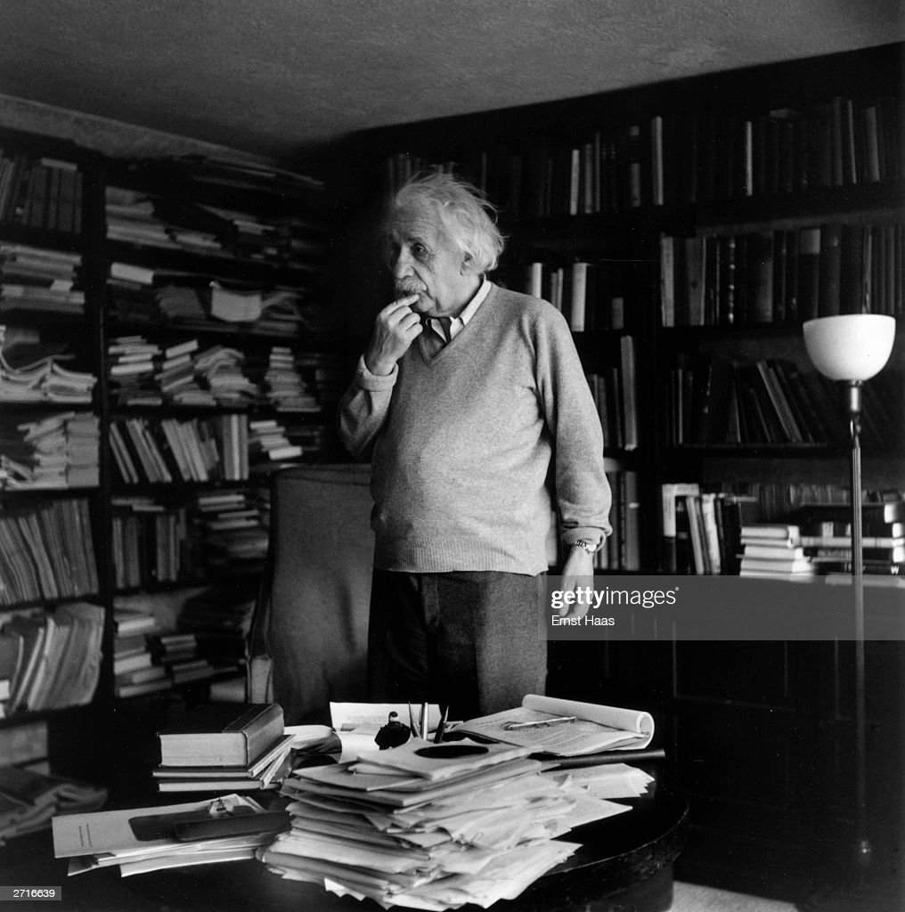 Premium Rates Apply. German born physicist who formulated the theories of relativity, Albert Einstein (1879 - 1955) ponders a problem in his paper-filled study in Princeton, New Jersey. A Nobel prize-winner for Physics in 1921. Original Publication: In black and white book