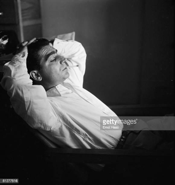 Premium Rates Apply Hungarianborn photojournalist Robert Capa at a meeting of the Magnum photographic cooperative Paris circa 1947