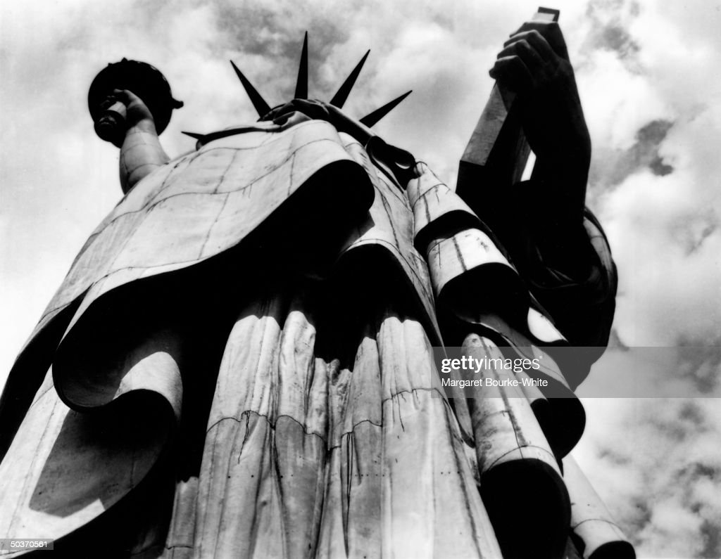 Premium Rates Apply. Low angle of the Statue of Liberty, from base looking up.