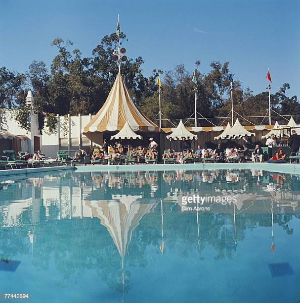 Premium Rates Apply Sunshades and sun loungers by the swimming pool at The Beverly Hills Hotel Beverly Hills California 1957