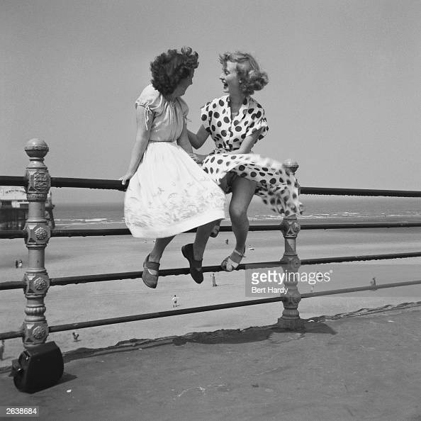 Premium Rates Apply Two women chatting on the railings in Blackpool The picture was taken by Bert Hardy using a singlefocus box camera The women are...