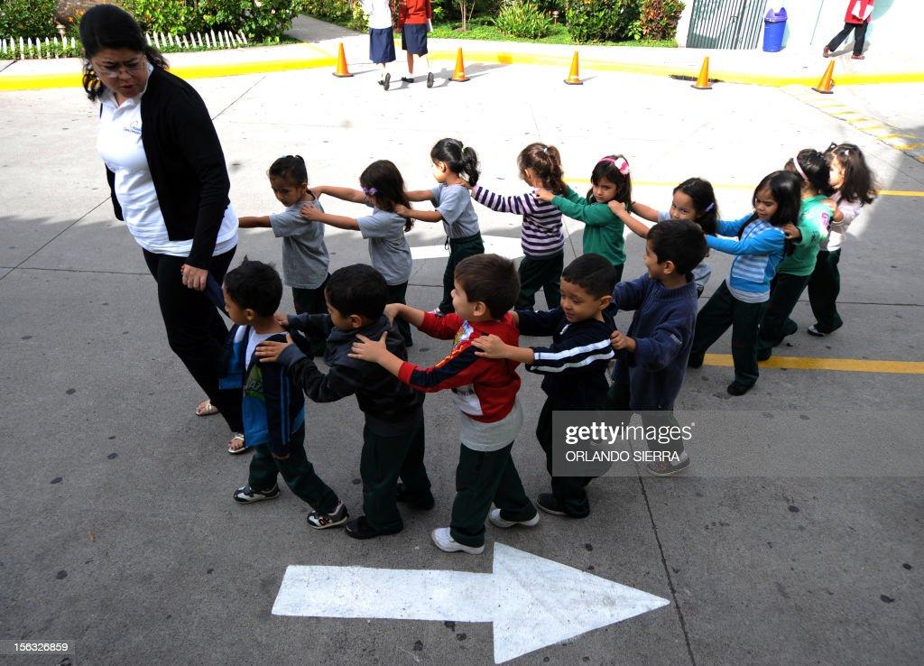 Prep pupils head to a gym class at a school in Tegucigalpa on November 13, 2012. AFP PHOTO/Orlando SIERRA