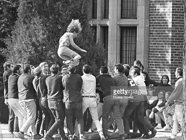 NOV 24 1968 PreParade activities included a Lmbda chi alpha fraternity Blnket Toss Getting whipped into the air by fraternity men is Lynn Trebilcox...