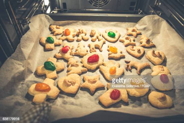 Preparation of Christmas cookies in oven