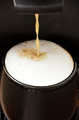 preparation of coffee with milk in the coffee machine
