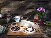 preparation of focacci with cherries.