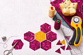 Preparation of hexagon pieces of fabric for sewing a quilt Grandmother's Flower Garden