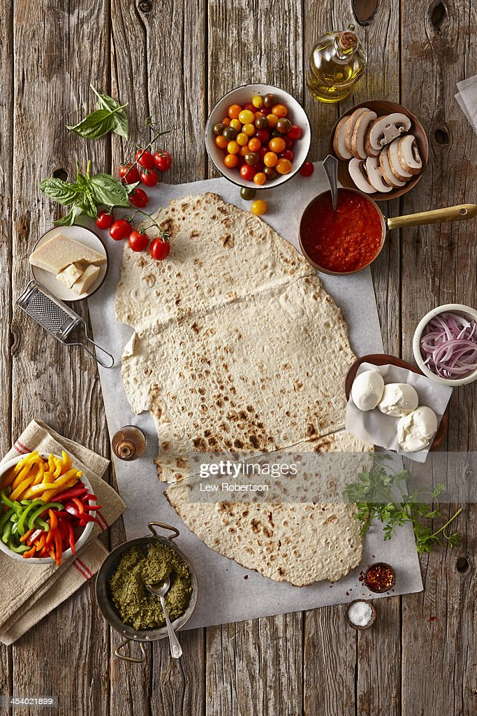 Preparation of making flatbread pizza : Stock Photo
