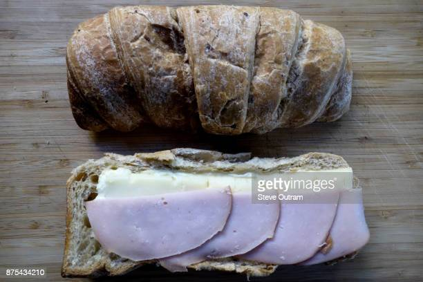 Preparation of Multigrain Croissant with Smoked Turkey Fillet, Mayonnaise and Edam Cheese
