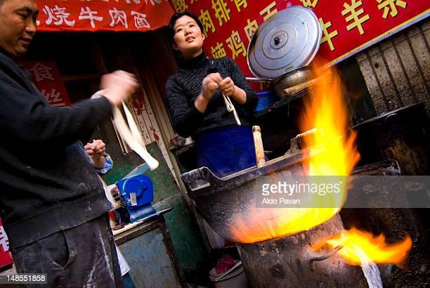Preparation of noodles at street night market.