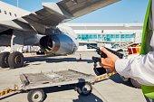 Ground staff preparing the passenger airplane before flight.