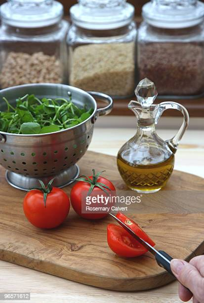 Preparation of water cress and tomato salad.