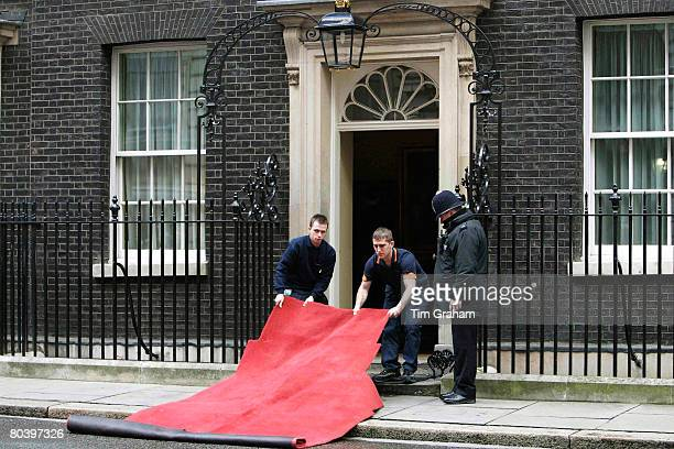 Preparations are made outside the entrance of Number 10 Downing Street prior to the visit by French President Nicolas Sarkozy and his wife first lady...
