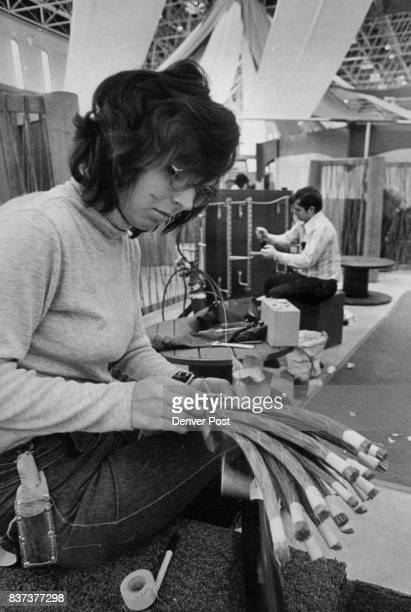 Preparations Made For Expo Mrs Linda Cammack a Mountain Bell cable splicer from Boise Idaho works on the telephone company's display at Explo the...