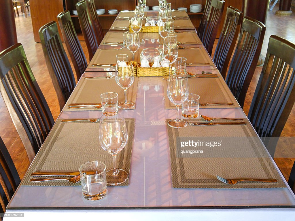 Prepare Dining Table In A Traditional Restaurant With Beige Napkins Stock Photo