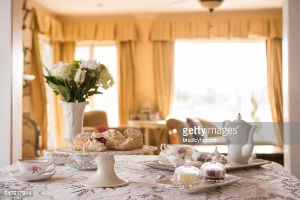 Prepared English tea and scones in living room