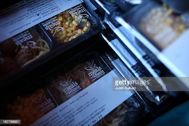 Prepared meals sit in a box in the kitchen at Meals On Wheels of San Francisco on February 27 2013 in San Francisco California Programs for the poor...