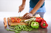 Cropped closeup shot of a woman cutting up vegetables on a cutting boardhttp://195.154.178.81/DATA/istock_collage/0/shoots/783564.jpg