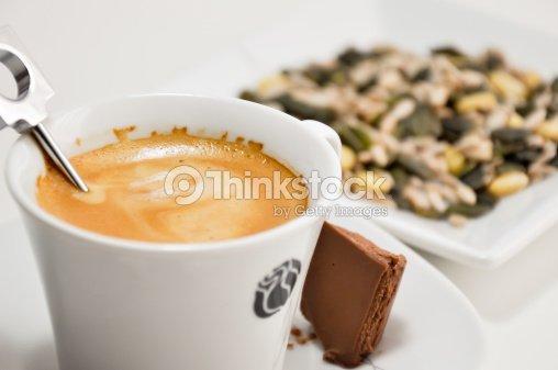 preparing a nespresso coffee cup stock photo thinkstock