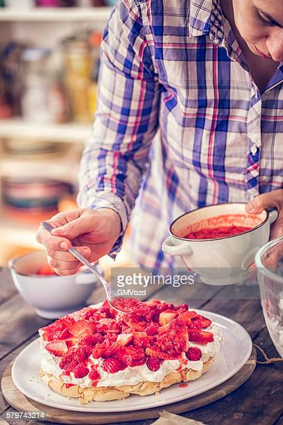 Preparing Berry Pavlova Cake with Strawberries and Raspberries