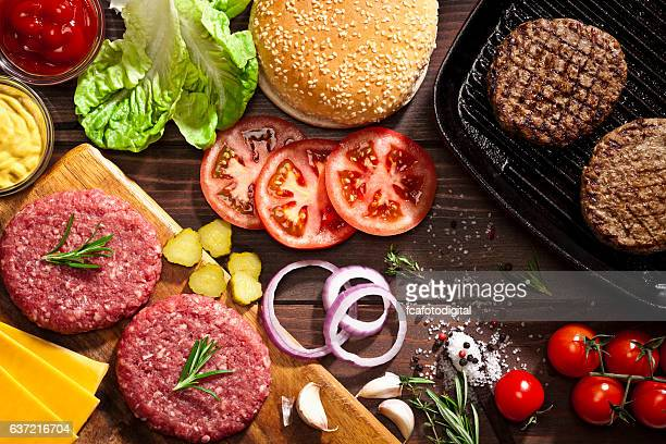 Preparing cheeseburger