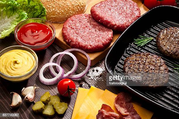 Preparing cheeseburger