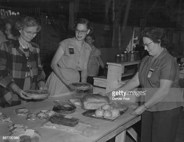 Preparing entries in the food division of the Moffat County fair are Mrs Henry Silver Mrs Dean Visintainer and 4H and adult exhibitors Credit Denver...