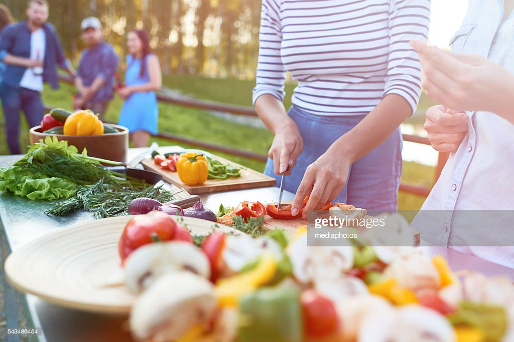 Preparing food outdoors : Stock Photo