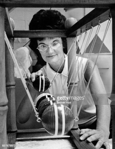 Preparing for museum's opening Mrs ***** Jamison checks to see that croquet ball pendulum is in balance and is ready for use Credit The Denver Post