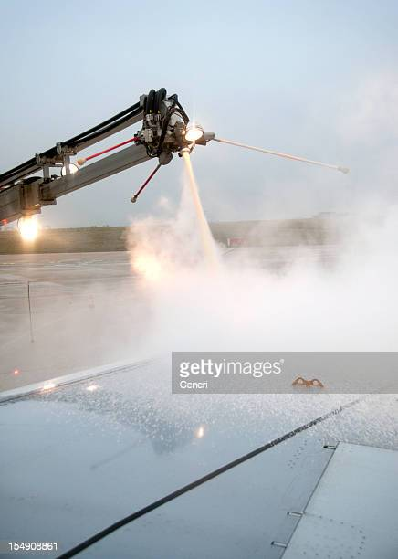 Preparing for takeoff: Airplane getting de-iced in Winter