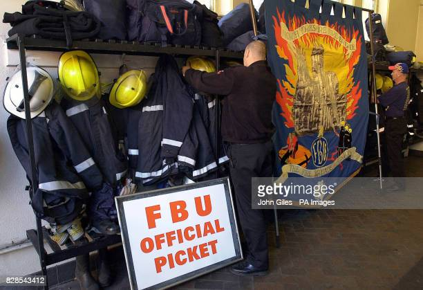 Preparing for the picket line as Firemen finish a shift at York Fire Station with their barriers and Union Banner waiting to be placed outside their...