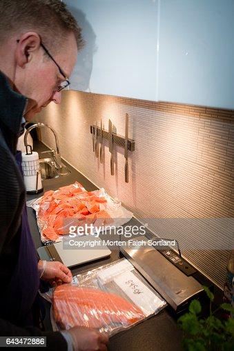 Preparing Fresh Salmon For Storage Stock Photo