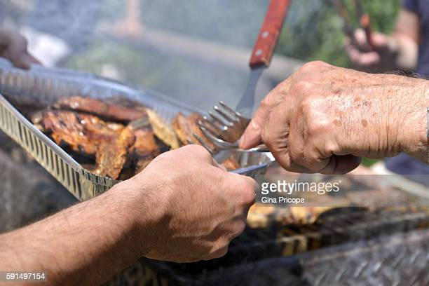 Preparing grilled meats during the Feast of the Assumption of the Blessed virgin Mary.