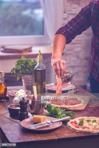 Preparing Homemade Pizza at Home