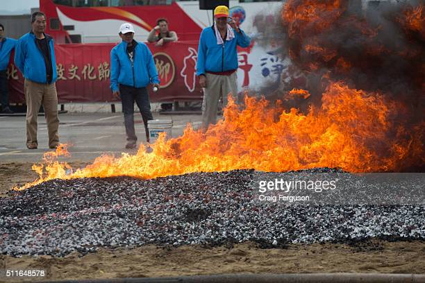 Preparing hot coals for a ritual where local temples will carry God icons across the fire The annual harbour cleansing ritual is to ensure safety at...