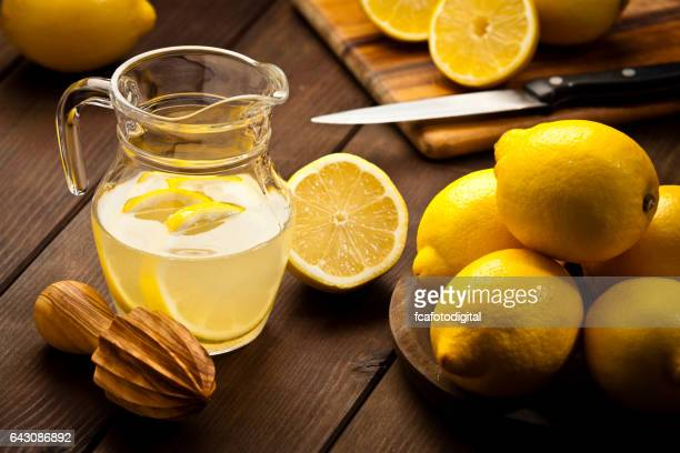 Preparing infused lemon detox drink