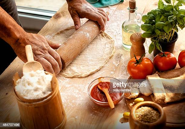 Preparing ingredients of homemade pizza